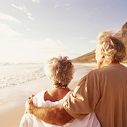 Senior couple standing on a beach in the morning