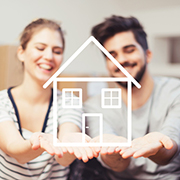 Male and female couple holding out their hands with a simple cartoon drawing of a house sitting in their palms