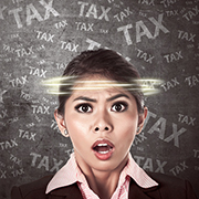 "Woman with a concerned expression on her face and the word ""tax"" swirling around her head"